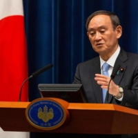 Prime Minister Yoshihide Suga speaks during a news conference in Tokyo on March 5. | POOL / VIA AFP-JIJI