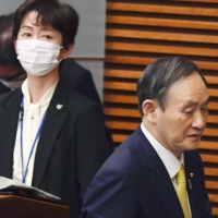 Former Cabinet Public Relations Secretary Makiko Yamada attends a news conference by Prime Minister Yoshihide Suga in Tokyo in December. | KYODO