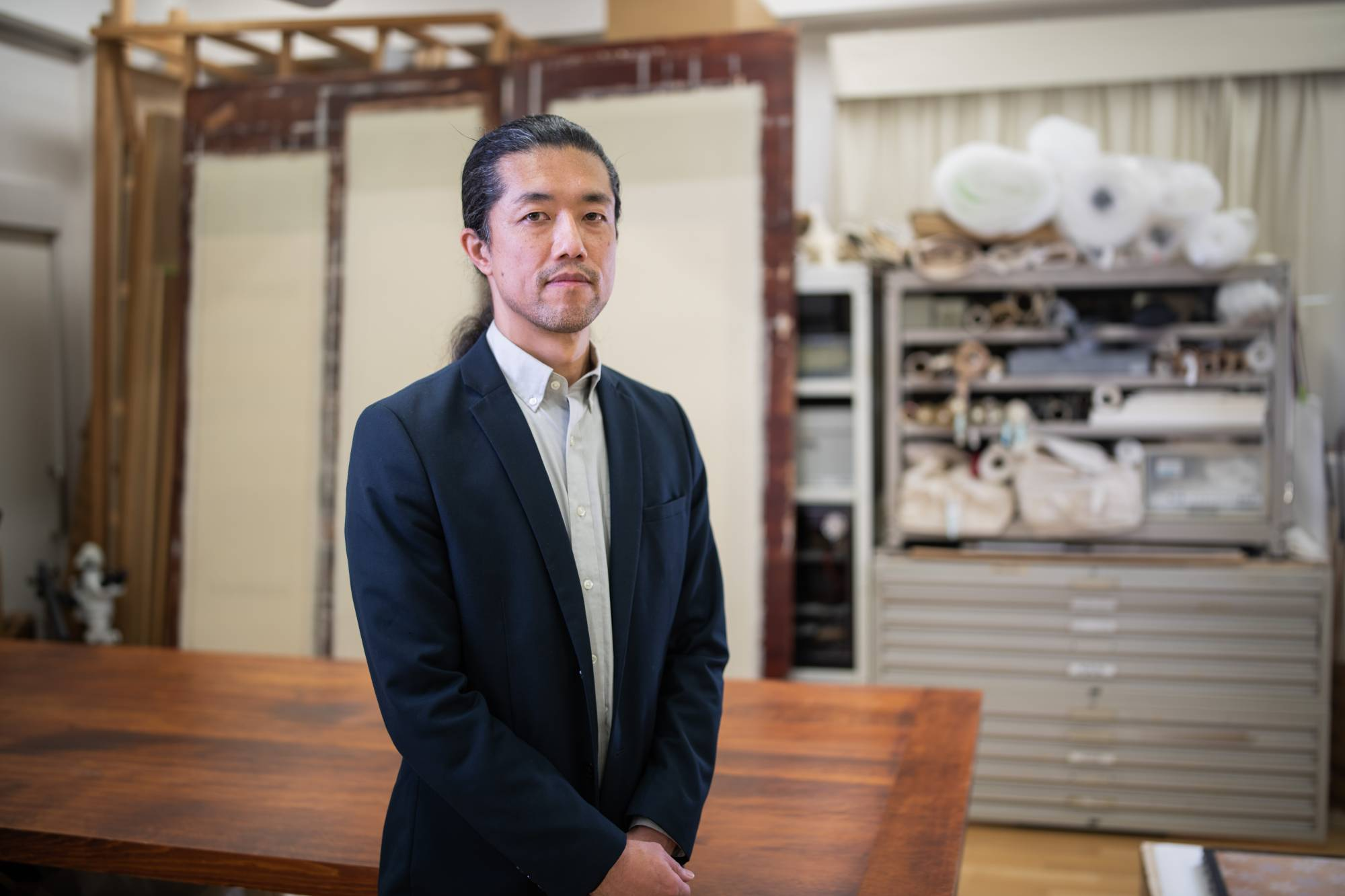 Touch of culture: Keisuke Sugiyama worries that as Japanese homes become more Westernized, traditional elements like hanging scrolls could disappear.  |