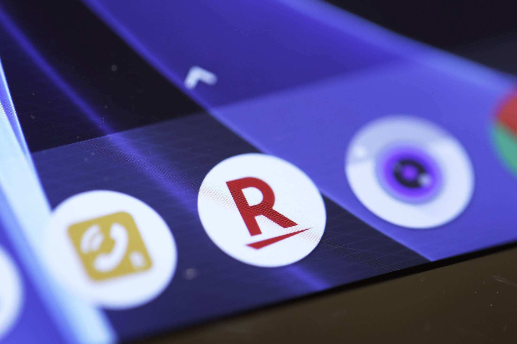 The icon for the Rakuten Inc. e-commerce store app is displayed on a smartphone inside the company's cafe in Tokyo in January 2019. | BLOOMBERG
