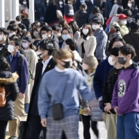 People visit Tokyo's Shinjuku district on Thursday. | KYODO