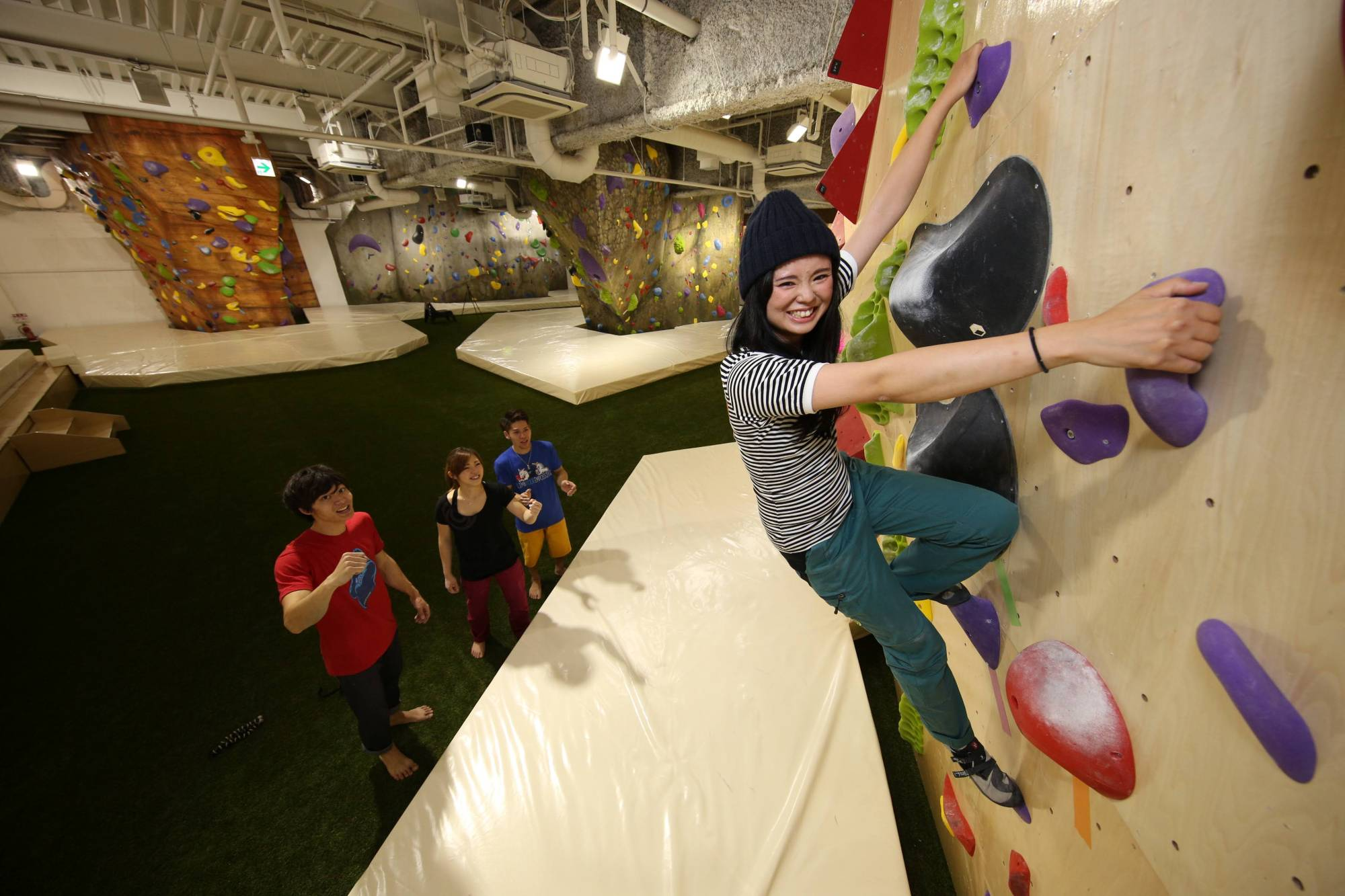 A climber scales the bouldering wall at B-Pump Ogikubo climbing gym.   COURTESY OF FRONTIER SPIRITS