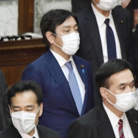 Former trade minister Isshu Sugawara attends a Lower House plenary session in Tokyo on Friday. | KYODO