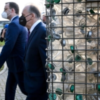 German Health Minister Jens Spahn and Saxony-Anhalt's Prime Minister Reiner Haseloff visit an IDT Biologika facility in Dessau Rosslau, Germany, in November 2020. | POOL / VIA REUTERS