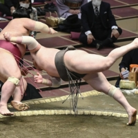 Yokozuna Hakuho ends long layoff with narrow win at Spring Basho