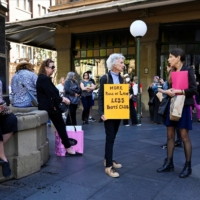 Protesters rally outside Town Hall in response to the treatment of women in politics following several sexual assault allegations, in Sydney on Monday. | REUTERS