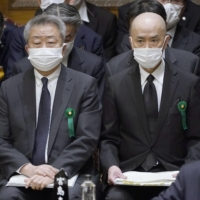 Nippon Telegraph and Telephone Corp. President Jun Sawada (left) and Tohokushinsha Film Corp. President Shinya Nakajima attend an Upper House Budget Committee session on Monday. | KYODO