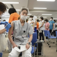 Japan considers COVID-19 vaccination certificates as calls from abroad grow