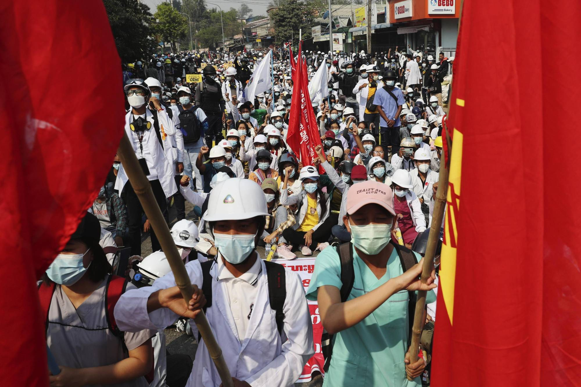 People take to the streets in Mandalay, Myanmar, to protest against the military coup on Saturday.  | AP / VIA KYODO