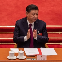 Chinese President Xi Jinping applauds after a vote on changes to Hong Kong's election system during the closing session of the National People's Congress at the Great Hall of the People in Beijing on Thursday.  | AFP-JIJI