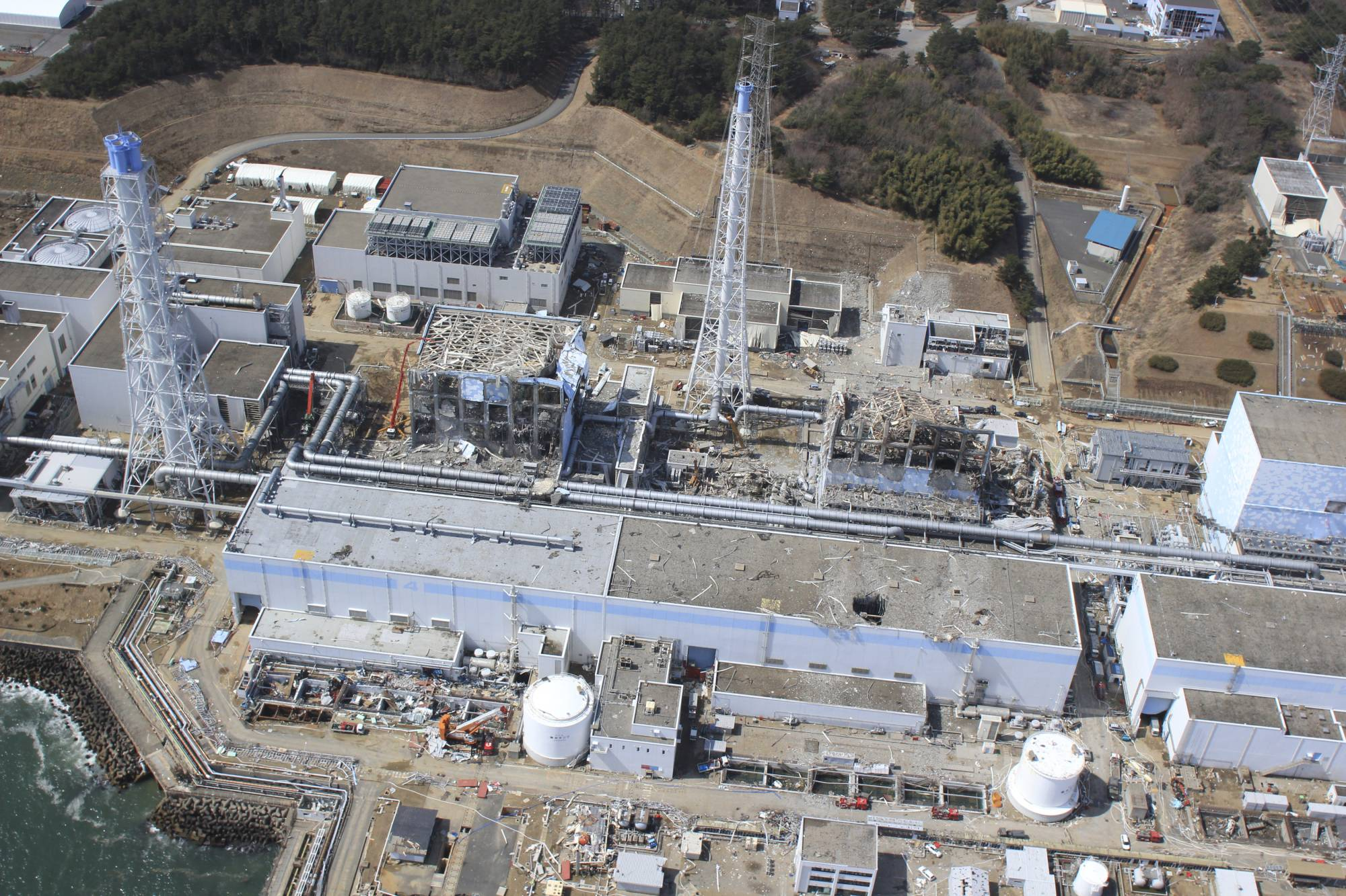The Fukushima nuclear disaster of March 2011 has been the subject of reviews and reports, 10 years since the plant experienced meltdowns following the Great East Japan Earthquake and tsunami. | AIR PHOTO SERVICE / VIA REUTERS