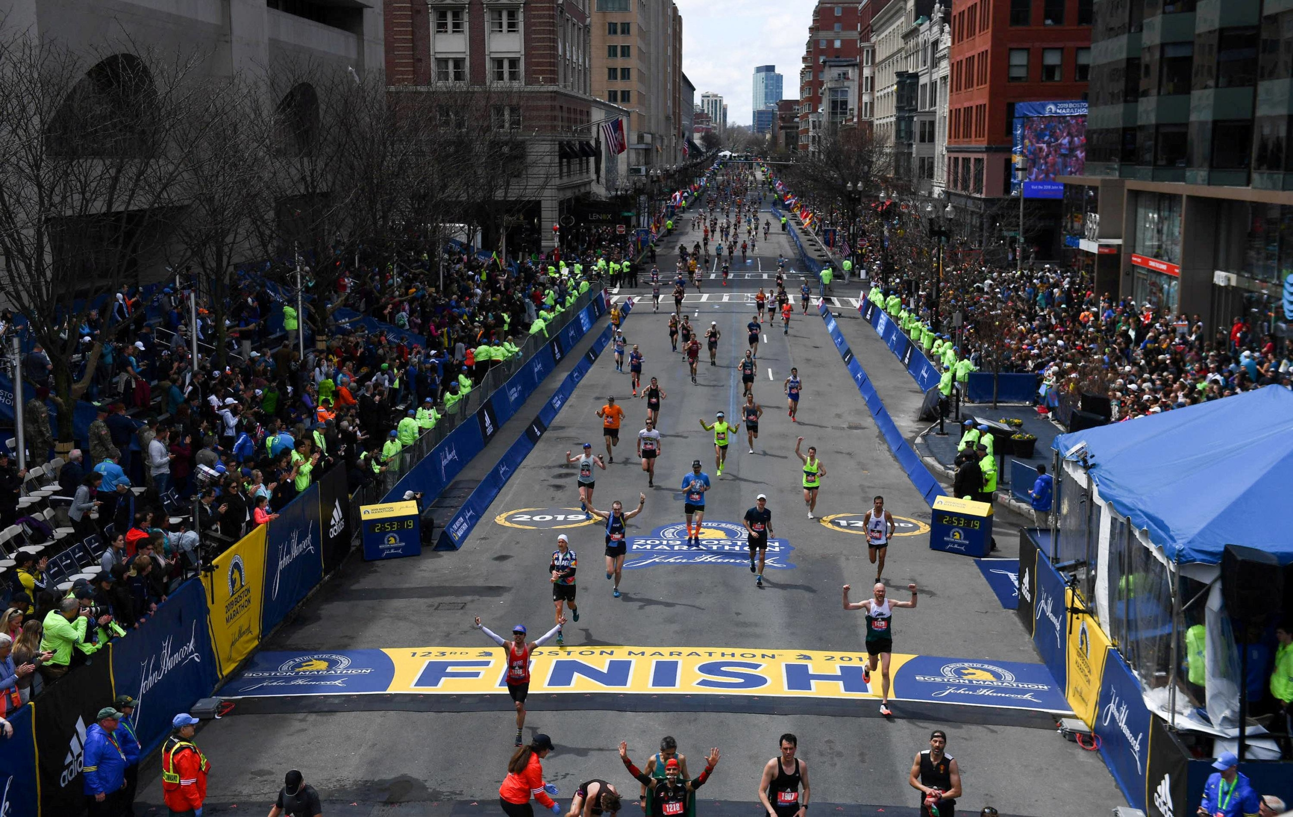 Runners approach the finish line on Boylston Street during the 123rd Boston Marathon in Boston on April 15, 2019.
