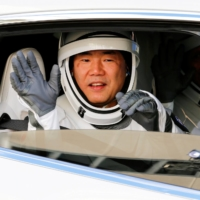 Japan Aerospace Exploration Agency astronaut Soichi Noguchi departs for the launch pad with other crew members of the SpaceX Falcon 9 rocket at the Kennedy Space Center in Cape Canaveral, Florida, in November 2020. Noguchi is currently aboard the International Space Station.  | REUTERS