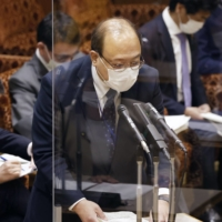 Yasuhiko Taniwaki, a senior communications ministry official with close ties to Prime Minister Yoshihide Suga, resigned Tuesday over a wining and dining scandal. | KYODO