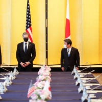U.S. Secretary of State Antony Blinken (second from left), U.S. Defense Secretary Lloyd Austin (left), Foreign Minister Toshimitsu Motegi (second from right) and Defense Minister Nobuo Kishi attend the 'two-plus-two' meeting in Tokyo on Tuesday. | POOL / VIA REUTERS