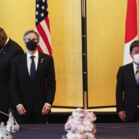 U.S. Defense Secretary Lloyd Austin (left), U.S. Secretary of State Antony Blinken (second from left) and Foreign Minister Toshimitsu Motegi attend the 'two-plus-two' meeting in Tokyo on Tuesday. | POOL / VIA AFP-JIJI