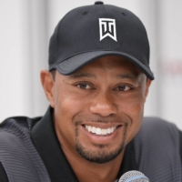 Tiger Woods announced on Tuesday that he is recovering at home after being released from the hospital. Woods suffered severe leg injuries in a car accident last month. | AFP-JIJI