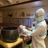 A cleaning specialist disinfects the premises of Kokunji, a temple in Fukuoka Prefecture that was the site of a COVID-19 cluster.  | COURTESY OF KOKUNJI