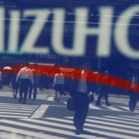 More than 4,300, or about 80%, of Mizuho's automated teller machines were hit by a glitch in late February, leaving some customers unable to retrieve their bank cards or books. | REUTERS