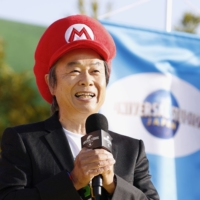 Nintendo Co.'s Super Mario games creator Shigeru Miyamoto speaks at the opening ceremony for Super Nintendo World at Universal Studios Japan in Osaka on Thursday. | KYODO