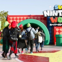 Visitors line up to enter the newly opened Super Nintendo World at Universal Studios Japan in Osaka on Thursday. | KYODO