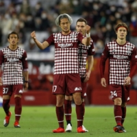 Vissel's Ryuho Kikuchi (center) and his teammates react after earning a draw against Frontale on Wednesday in Kobe.  | KYODO