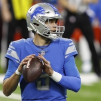Lions quarterback Matthew Stafford looks to pass against the Packers during the first quarter in Detroit on Dec. 13, 2020. | USA TODAY / VIA REUTERS