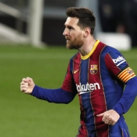 Barcelona's Lionel Messi celebrates after scoring against Huesca in Barcelona on March 15. | REUTERS