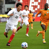 Japan's Takehiro Tomiyasu controls the ball during a friendly against Cote d'Ivoire in Utrecht, Netherlands, on Oct. 13, 2020. | REUTERS