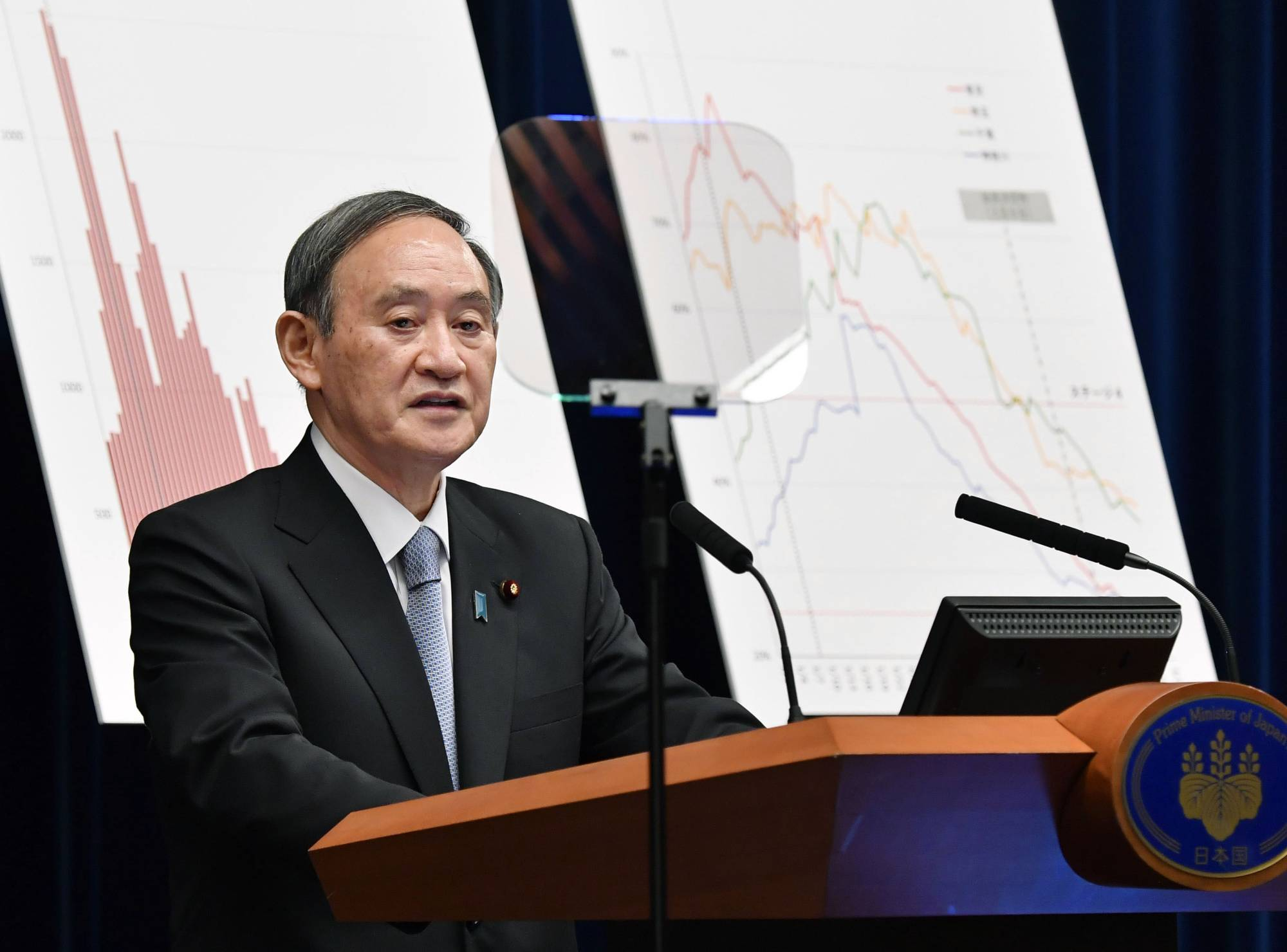 Prime Minister Yoshihide Suga speaks at a news conference held at the Prime Minister's Office on Thursday after the government decided to end the state of emergency for the Tokyo metropolitan region on Sunday. | KYODO