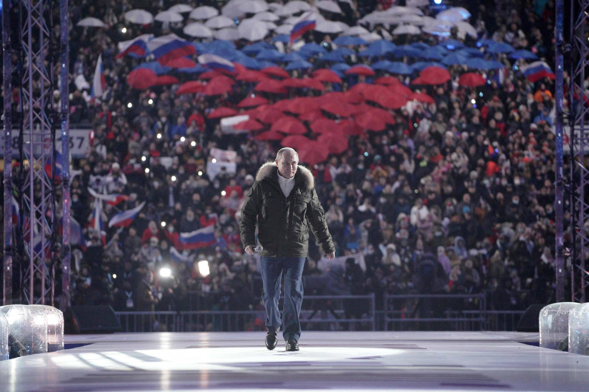 Russian President Vladimir Putin attends a concert marking the seventh anniversary of Russia's annexation of Crimea in Moscow on Thursday. | SPUTNIK / VIA AFP-JIJI