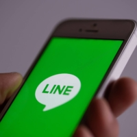 Japan reviewing government use of Line app, Suga says