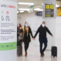 An information placard is pictured as tourists from Germany arrive to Palma de Mallorca Airport following Berlin's lifted quarantine requirement for travelers returning from the Balearic Islands amid the COVID-19 pandemic, in Palma de Mallorca, Spain, on Friday.