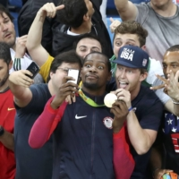 Team USA's Kevin Durant takes a selfie with fans after the men's basketball final at the 2016 Rio Olympics.  | REUTERS
