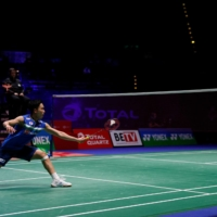Kento Momoto hits a shot against Lee Zii Jia during the All England Open in Birmingham, England, on Friday. | AFP-JIJI