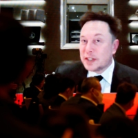 Tesla Inc. Chief Executive Officer Elon Musk attends via video link a session at the China Development Forum held in Beijing on Saturday. | REUTERS