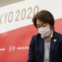 Tokyo 2020 Organising Committee chief Seiko Hashimoto leaves after a news conference following a five-party meeting of the Tokyo 2020 Olympic and Paralympic Games in the capital on Saturday.  | POOL / VIA AFP-JIJI