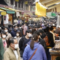 A shopping street in Tokyo's Ueno district is crowded on Saturday ahead of the lifting of the coronavirus state of emergency. The capital reported 187 new cases of COVID-19 on Monday. | KYODO