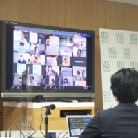 A screen displays an online gathering with volunteers for the 2020 Olympics in Tokyo in July 2020. | NIPPON FOUNDATION VOLUNTEER SUPPORT CENTER / VIA REUTERS