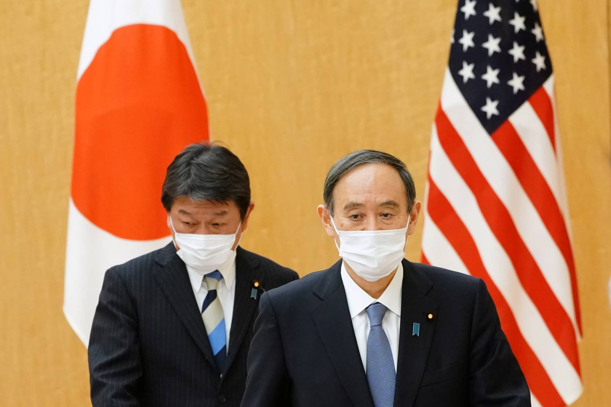 Prime Minister Yoshihide Suga and Foreign Minister Toshimitsu Motegi attend a meeting with the U.S. Secretary of State Antony Blinken at the Prime Minister's office in Tokyo on March 16. | REUTERS