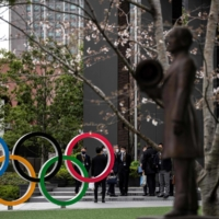 Tokyo Olympics organizing committee said it will not accept volunteers from overseas in principle amid the coronavirus pandemic. | AFP-JIJI