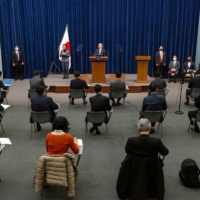 Members of the media attend a news conference held by Prime Minister Yoshihide Suga in Tokyo on March 5. | POOL /VIA REUTERS