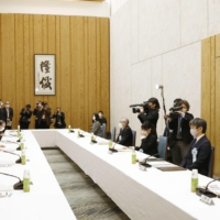 Prime Minister Yoshihide Suga (third from left) attends the first meeting of an advisory panel on securing a stable line of imperial succession at the Prime Minister's Office on Tuesday. | KYODO