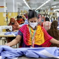 A woman works in a garment factory in Dhaka in May last year.  | REUTERS