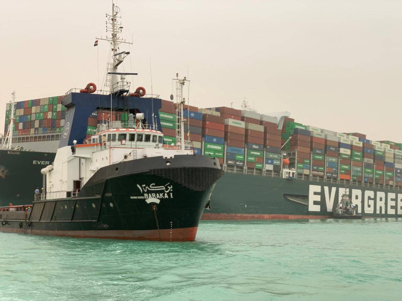 A handout picture released by the Suez Canal Authority on March 24, 2021 shows the MV Ever Given, operated by Taiwanese firm Evergreen, grounded in the Suez Canal, Egypt. | SUEZ CANAL / AFP-JIJI