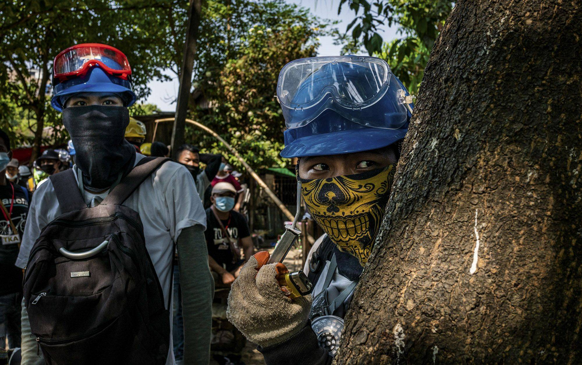 Protesters look for military forcesin Yangon, Myanmar, on March 20. | GETTY IMAGES / VIA BLOOMBERG