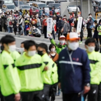 People in Fukushima Prefecture expressed mixed feelings for holding the summer Olympic Games as torch relay kicked off Thursday amid the coronavirus pandemic. | REUTERS