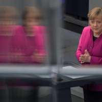 German Chancellor Angela Merkel addresses delegates at the Bundestag in Berlin on Thursday ahead of an EU summit. | AFP-JIJI