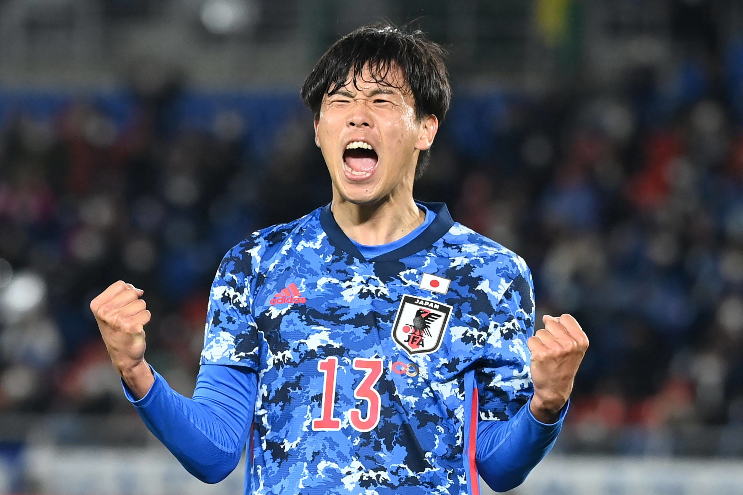 Miki Yamane celebrates after scoring Japan's first goal against South Korea on Thursday in Yokohama. | AFP-JIJI