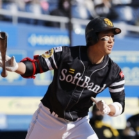 The Hawks' Ryoya Kurihara hits a home run against the Marines during the seventh inning of a spring training game in Chiba on March 14. | KYODO